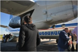 Self-unloading cargo and luggage from the Antonov AN-26-100 at Yakutsk airport. Luggage is strictly limited to 20kg per person and every spare gram is filled with frozen fish (Chir), being the heaviest part of the luggage (Photo: L. Schaepman, July 2013).