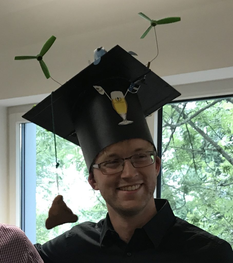 Patrick with his graduation hat